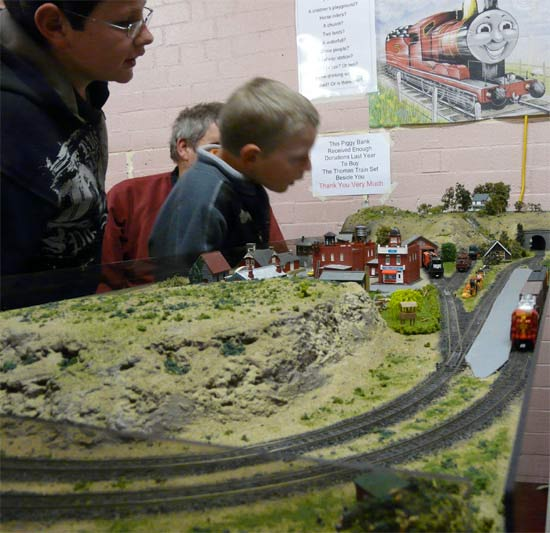 Children playing with the Orsnow layout