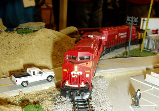 Bright red Canadian Pacific train at road crossing